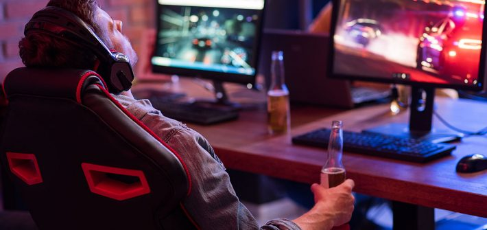 gamer sitting in a comfortable gaming chair drinking mountain dew